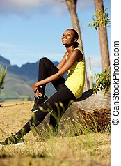 Happy african woman taking break from workout - Portrait of...