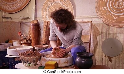 Fast motion video shot of a Potter working with clay on a...