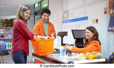 Customer in line at checkout - Customer in line in a market...