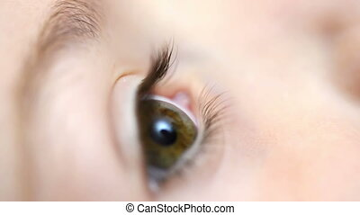 Eye Drop for children - Close up of an eye of a child...