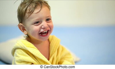 Baby Laughing After Bath - Cute baby wearing a bath robe...