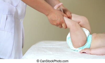 Physiotherapy for Baby - Baby boy getting physiotherapy,...
