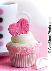 Cupcake love - Cupcake decorated with a fondant heart and...