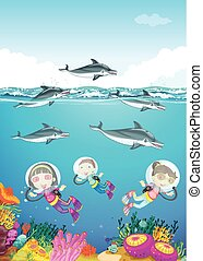 Dolphins and kids swimming under the sea illustration