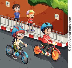 Children riding bicycle on the road with helmet on