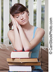 take a break - female student with pile of books takes a...