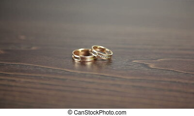 Wedding rings on the table rotation Full HD
