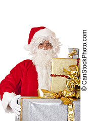 Old Santa Claus holding Christmas gift boxes in hands