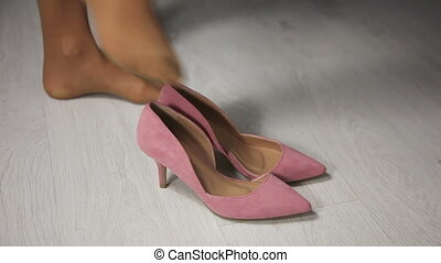 woman wears pink shoes