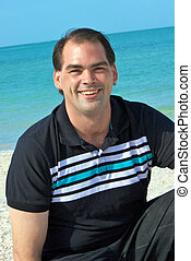 friendly smiling man at beach