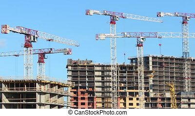 tower cranes construction time laps - tower cranes on the...