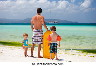 Family on vacation - Happy father with his two kids on...
