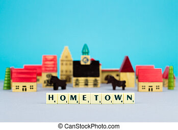 Figurine hometown on blue background with sign