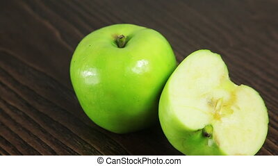 Green apple on the table rotates