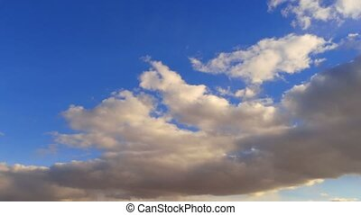 White clouds running over deep blue sky