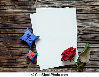 Blank papers on table with rose and gift - Pair of stacked...
