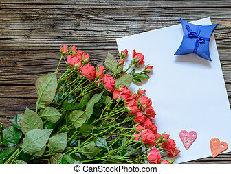 Blank sheet of paper on wooden surface with roses - Single...