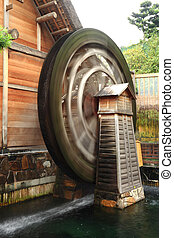 wooden waterwheel rotating