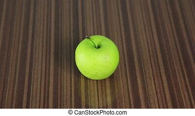 Green apple, a piece bitten off. Full HD