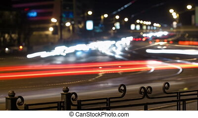 City traffic panning time lapse at night.