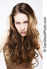 Portrait of long haired young woman with highlighted brown...