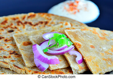 Paratha flatbread Indian cuisine. Food background and...