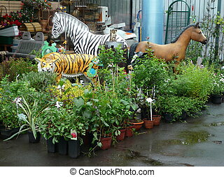 toy animals in garden at day