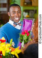 Handsome Man in Flower Shop Buys Roses - Handsome man...