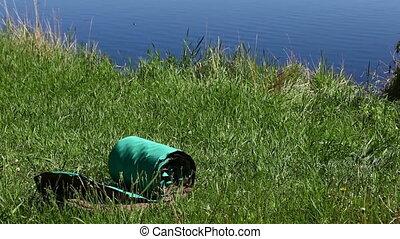 Air tourist mat on the grass meadow