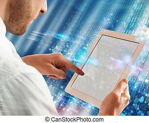 New technology - Businessman touching the screen of a tablet