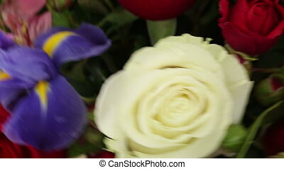 Beautiful bouquet roses, iris and alstroemeria quickly...
