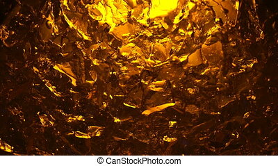 Abstract surface with amber colors internal lighting