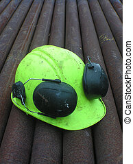 HARD HAT - hard hat on pipes for drill string at oil well,...