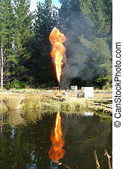 gas flare - Flare burning off gas and oil at Niagara 1 oil...