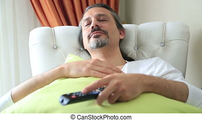 Yawning middle age man on couch