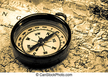 Compass on a map in warm tones