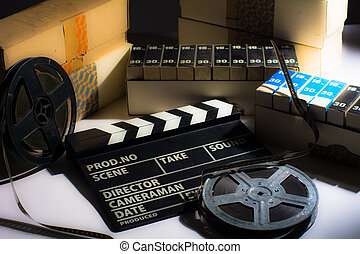 Reel with film and cinema clap Motion picture films in boxes...