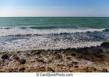 sunny windy day - Sea shore with surf in the sunny windy day