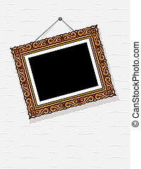 empty picture in decorative frame on wall