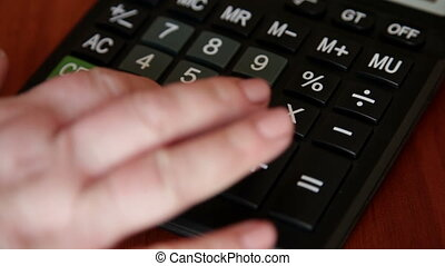 Female hand typing digits on keyboard - Female hand typing...