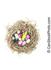 easter eggs in nest - chocolate easter eggs in a nest on...