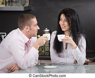 Morning coffee - Happy young couple having their morning...