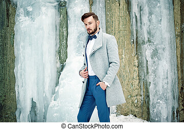 Outdoor portrait of handsome man in gray coat Fashion photo...