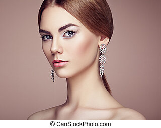 Fashion portrait of young beautiful woman with jewelry....