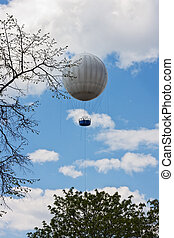 gas balloon - Flight of a gas balloon in a cloudy sky