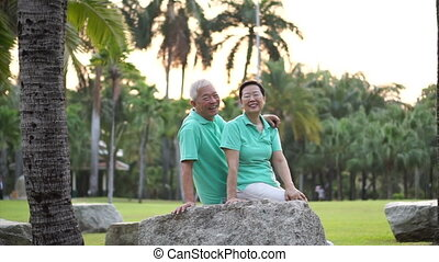 Asian senior exercise in the park - Happy Asian senior...