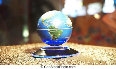 Globe spinning on magnetic power - Blue Planet Earth...