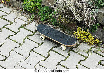 Skate - Old child skateboard on the pavement