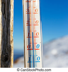 thermometer strapped on a post outside in the mountain,...