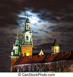 Full moon over Wawel Castle in the night in Krakow, Poland